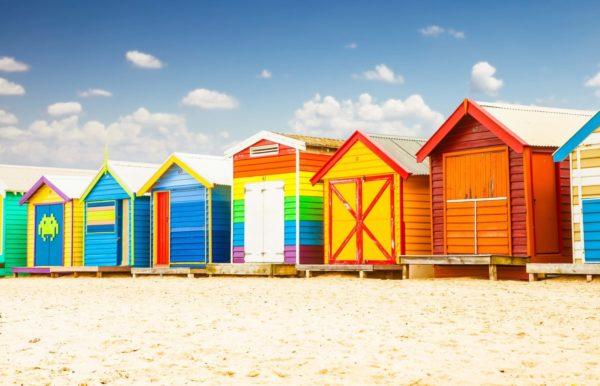 Beautiful Bathing houses on white sandy beach at Brighton in Melbourne, Australia.