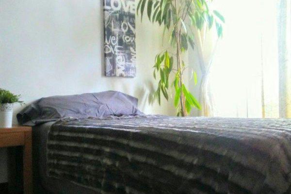 Bett bei einer Gastfamilie auf Menorca